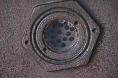 A peephole in iron door of gas chamber.